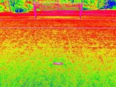 Wild colors of thermography photo.  Empty outdoor handball playground, plastic light green surface on ground and white blue bounds lines. — Stock Photo
