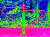 Seesaw in crawl construction on modern kids playground. Infrared scan in amazing thermography colors. — Stock Photo