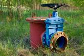 Old expansion pipe of drink water pipes joined with new blue valve and new blue joint members. New dump valve.  Extreme kind of corrosion, metal corroded texture. — Stock Photo