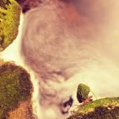 Mountain foamy stream among the green mossy stones — Stock Photo