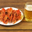 Tasty boiled crayfish and beer on a table — Stock Photo #54417375