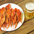 Tasty boiled crayfish and beer on a table — Stock Photo #54417377