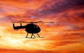 Picture of helicopter at sunset. Silhouette of helicopter on sun — Стоковое фото