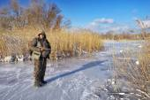 Hunter on the ice pond waiting victim. Hunter fully prepared. — Stock Photo