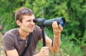 Man who is watching in spotting scope. — Stock Photo