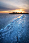 Winter landscape with frozen lake and sunset sky. Composition of — Foto de Stock