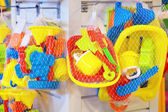 Set of multicolored toys for baby on sale in the shop. — Stock Photo