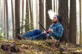 Male worker relaxing in the woods — Stock Photo