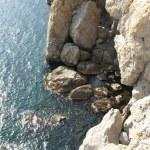 Sea stones under high mountain — Stock Photo #53553247