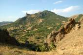 View from Karadag volcanic mountain range to Meganom cape in Eastern Crimea, on a Black Sea shore. — Stock Photo