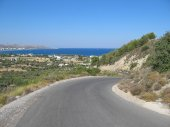 Straight asphalt road along the sea on the greek Island of Rhodes — Stock Photo