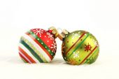 Two colorful Christmas balls on white fur background — Stock Photo