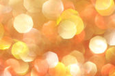Yellow, orange, red sparkle abstract background - soft lights — Stock Photo