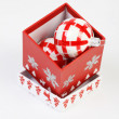Red Christmas filled box with red and white Christmas decoration on white background. Open Christmas box with red and white christmas ball inside. — Stock Photo #57444655