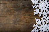 Snowflakes on a wooden background — Stock Photo