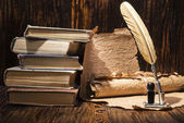 Vintage golden pen and ancient manuscripts — Stock Photo