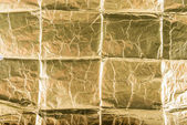 Crumpled golden foil background — Stock Photo