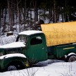 An antique truck with a blank sign abandoned in the snow — Stock Photo #63829457