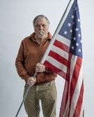 Older man with American Flag — Stock Photo