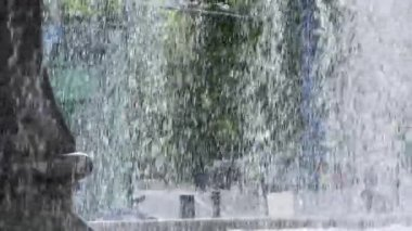 City Lifestyle Behind Waterfall Fountain — Stock Video