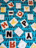 Alphabets on a Fabric Carpet Surface — Stock Photo