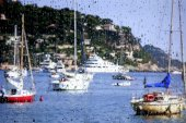 View on the French coast with yachts through the glass with rain — Stock Photo