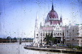 View on the streets of Budapest through the glass with raindrops — Stock Photo