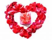 Beautiful heart of red rose petals — Stock Photo
