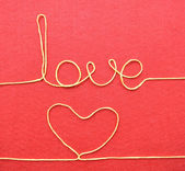 Heart and word made from wire — Stock Photo