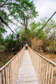 People on suspension bridge — Stock Photo