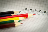 Spiral notepad with set of color pencils. — Stock Photo