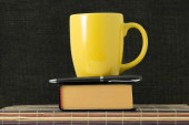 Cup, handle and book — Stockfoto