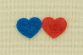 Blue and red hearts on a light background — Stock Photo