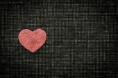 Heart and love symbol against a dark background — Stock Photo