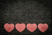 Symbols of hearts and love against a dark background — Stock Photo