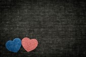 Blue and red hearts against a dark background — Stock Photo