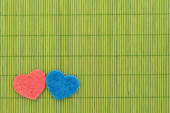 Blue and red hearts against bamboo sticks — 图库照片