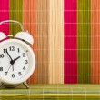 Table clock at coloured decorative background — Stock Photo #68314067