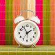 Table clock at coloured decorative background — Stock Photo #68314163