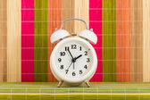 Table clock at coloured decorative background — Stock Photo