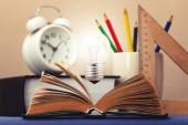 Light on the book symbolizes the idea — Stock Photo