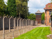 Fence and guard tower of concentration camp — Stock Photo