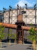 Gasholder in the industrial zone — Stock Photo