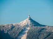 Hotel and transmitter Jested with ski slope — Stock Photo