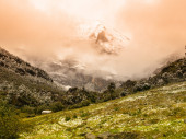 High mountain peak covered with fog — Stock Photo