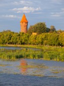 Round tower at the river — Stock Photo