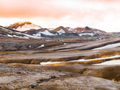 Rainbow mountains with fields of snow — Stock Photo
