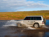 Fording offroad car — Stock Photo