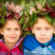 Boy and a girl wearing Wreath of Leaves — Stock Photo #58789291