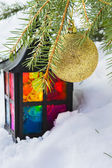 Decorative lantern in the snow and fur-tree branch with Christma — Photo